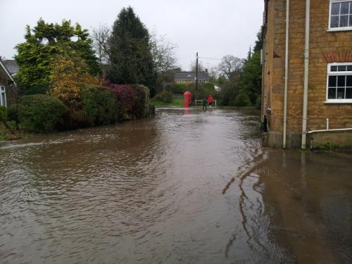 Water covering road and pavement