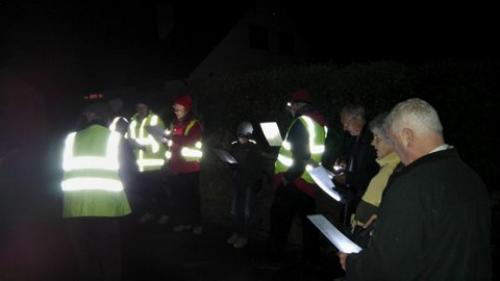 Carollers in the dark